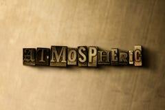 ATMOSFÉRICO - o close-up do vintage sujo typeset a palavra no contexto do metal ilustração royalty free