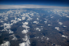 Atmosphere. A view of the atmosphere with clouds over earth Stock Photo