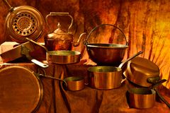 Atmosphere brass. Shooting environment different copper containers on a copper colored background Royalty Free Stock Photos