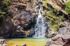 Atmosphere, mountains, sky, clouds Beautiful waterfalls Pileok Subdistrict in Mueang Kanchanaburi Old mine near the Thai-Burma royalty free stock images