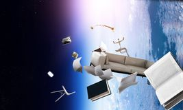 Office objects flying on orbit. Atmosphere of the planet Earth with office items on deep blue space background royalty free stock images