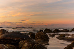 Atmosphere at sunrise on the beach Stock Image