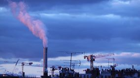 Atmospheric Air Pollution From Industrial Smoke billowing from Smoking pipes and cranes beside smoking pipes, ecology problems