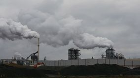 Atmospheric Air Pollution From Industrial Smoke Now. Pipes Steel Plant. Thick Smoke and Steam of MDF Production. Works in autumn Cloudy Day stock video