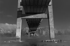 Atmospheric black and white photography the piece of bridge and river Royalty Free Stock Image