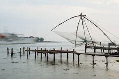 Chinese fishing nets in Kochi, India. Atmospheric Chinese fishing nets on a very moody day full of mist and gloom in Kerala, India. Long exposure Stock Image
