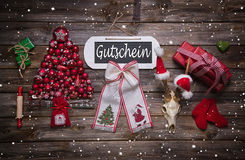 Atmospheric christmas decoration in red with german text on sign Royalty Free Stock Photo