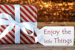 Atmospheric Christmas Gift With Label, Enjoy The Little Things Royalty Free Stock Photography
