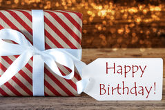 Atmospheric Christmas Gift With Label, Happy Birthday. Macro Of Christmas Gift Or Present On Atmospheric Wooden Background. Card For Seasons Greetings, Best Stock Photos