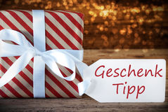 Atmospheric Christmas Present With Label, Geschenk Tipp Means Gift Tip Royalty Free Stock Photo