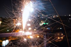 Atmospheric close-up of an exploding firecracker with a beautiful bokeh. New Year`s Eve. royalty free stock photo