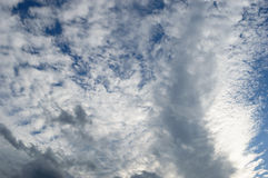 Atmospheric clouds moving in. On the bleu sky in the back Royalty Free Stock Photography