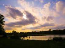 Atmospheric Clouds Over The Water stock images