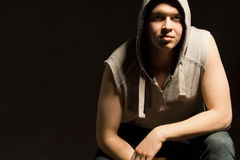 Atmospheric dark portrait of a fit young man Stock Photos