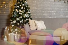 Atmospheric decoration of the room for the new year.New Year`s decor room. Beautiful decoration of the room for the new year..New Year`s decor room royalty free stock photo