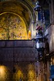 Vertical: Foreground of incense burner and Tree of Jesse mosaic inside St. Mark`s Balsica in Venice. Royalty Free Stock Image