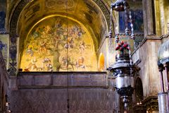Foreground of incense burner and Tree of Jesse mosaic inside St. Mark`s Balsica in Venice. Stock Photo