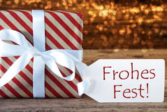 Atmospheric Gift With Label, Frohes Fest Means Merry Christmas Stock Images