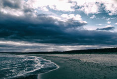 Atmospheric moody beach and clouds. Atmospheric and moody view of a beach on the East Coast of Scotland Royalty Free Stock Photo