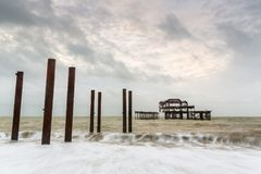 Atmospheric and Moody Long Exposure Photograph of the Ruins of the old Brighton West Pier at Brighton, East Sussex. England, UK Stock Image