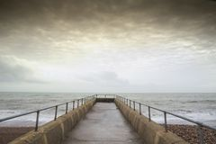 Atmospheric and Moody Long Exposure Photograph of Stone Pier at Brighton, East Sussex, England, UK with copy space.  Stock Photo