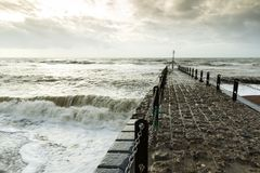 Atmospheric and Moody Photograph of Stone Pier at Brighton, East Sussex, England, UK.  Stock Image