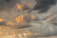 Atmospheric phenomena in the sky. Background of clouded sky with orange clouds Stock Images