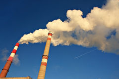 Atmospheric pollution. Emissions to the atmosphere caused by man-made human activities pollute the atmosphere and lead to the formation of the greenhouse effect Stock Photography