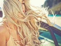 Atmospheric portrait of beautiful blonde in car Royalty Free Stock Images