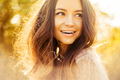 Atmospheric portrait of beautiful young lady. Outdoor atmospheric lifestyle photo of young beautiful lady. Brown hair and eyes. Warm autumn. Warm spring stock image