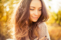 Atmospheric portrait of beautiful young lady. Outdoor atmospheric lifestyle photo of young beautiful lady. Brown hair and eyes. Warm autumn. Warm spring Stock Photography