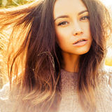 Atmospheric portrait of beautiful young lady. Outdoor atmospheric lifestyle photo of young beautiful lady. Brown hair and eyes. Warm autumn. Warm spring stock photo