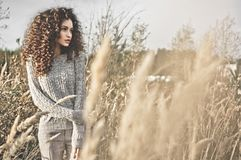 Atmospheric portrait of beautiful young lady. Outdoor atmospheric lifestyle photo of young beautiful lady. Brown hair and eyes. Warm fall. Autumn vibes. Softness Stock Photo