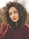 Atmospheric portrait of beautiful young lady. Outdoor atmospheric lifestyle photo of young beautiful lady. Brown hair and eyes. Warm fall. Autumn vibes. Softness Royalty Free Stock Photo