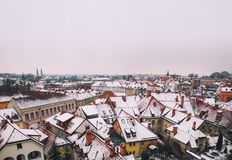 City Life of Ljubljana at winter, Slovenia, Europe. Atmospheric Real Winter Panoramic View of Ljubljana from Castle on the Snowy Red Roofs. Ljubljana, Slovenia Royalty Free Stock Image