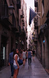 Atmospheric street in Barcelona. Barcelona, Spain - July 16, 2013: People can be seen walking through an atmospheric back street in the historical centre of stock photography