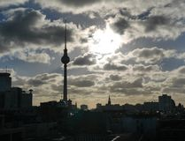 Atmospheric sunset over the Berlin cityscape. With a dramatic cloudy sky and silhouette of the buildings and Fernsehturm TV Tower Royalty Free Stock Images