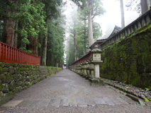 Atmospheric temple pathway. An atmospheric pathway in Niko, Japan Stock Photo