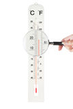 Atmospheric thermometer checked loupe for accuracy Stock Photos