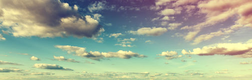 Atmospheric toned skyscape with clouds. Atmospheric toned panoramic skyscape with colorful clouds at sunset or sunrise in a nature or weather banner Stock Photo