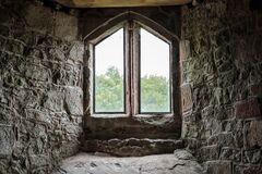 Free Atmospheric View Of A Medieval Building Seen From Within, Looking Out An Ornate Window. Stock Images - 185894154