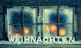 Atmospheric xmas window for a background with german text: Chris Stock Image