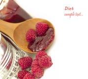 Atolamento das framboesas, conceito da dieta Fotografia de Stock Royalty Free