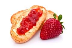 Atolamento de morango no pão Foto de Stock Royalty Free