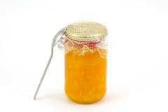 Atolamento do marmelade do citrino caseiro com uma colher Fotos de Stock Royalty Free