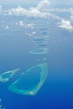 Atoll. Reefs and island of an atoll of the Maldives stock photography
