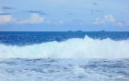 Atoll in the Pacific Ocean. A view of the atoll across the waves on the horizon with the islands,Philippines Stock Photo