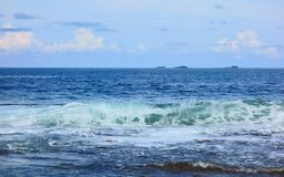 Atoll in the Pacific Ocean. A view of the atoll across the waves on the horizon with the islands,Philippines Stock Photography