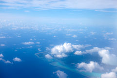 The atoll ring at ocean. Aerial view. Royalty Free Stock Image