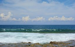 Atoll. A thrilling wave of the Pacific Ocean on the island of Siargao, Philippines Royalty Free Stock Photos
